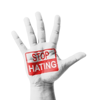 Open hand raised, Stop Hating sign painted, multi purpose concep